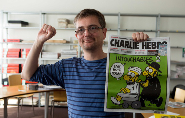648x415_french-satirical-weekly-charlie-hebdo-s-publisher-known-only-as-charb-presents-to-journalists-on